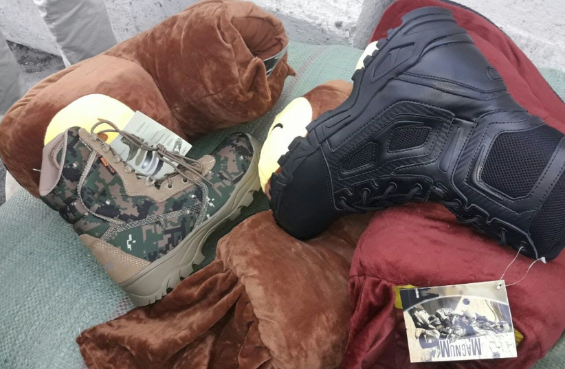 Military-grade shoes labeled as slippers destined for Hamas's military wing in Gaza (photo credit: COGAT SPOKESMAN)