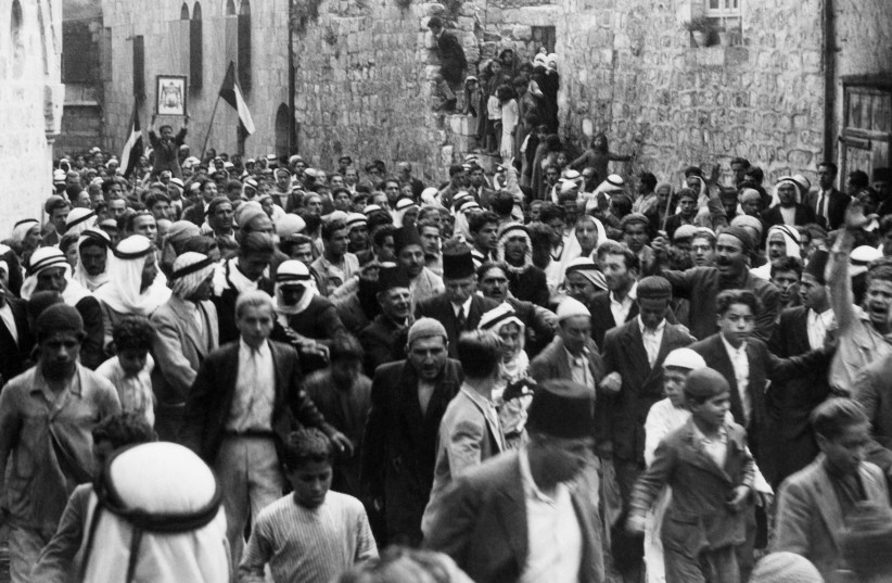 Palestinians demonstrate in the Old City of Jerusalem, 1937 (photo credit: AGENCE FRANCE PRESSE)