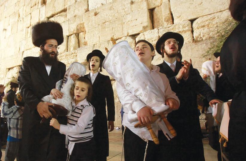 Celebrating Simhat Torah at the Western Wall. (photo credit: MARC ISRAEL SELLEM/THE JERUSALEM POST)