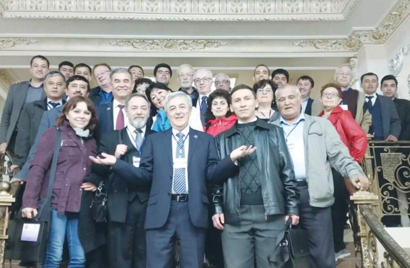 Participants in the Scientific Conference at the National University of Uzbekistan pose with Holon Institute of Technology President Eduard Yakubov (center) (photo credit: TATIANA SHOIKHET)
