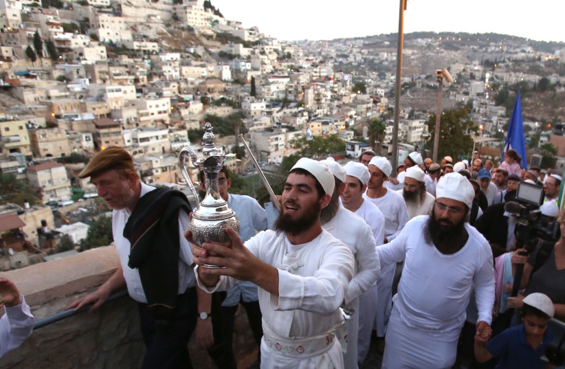 Cohanim holding the water libation instrument during the march in Ir David. (photo credit: MARC ISRAEL SELLEM)