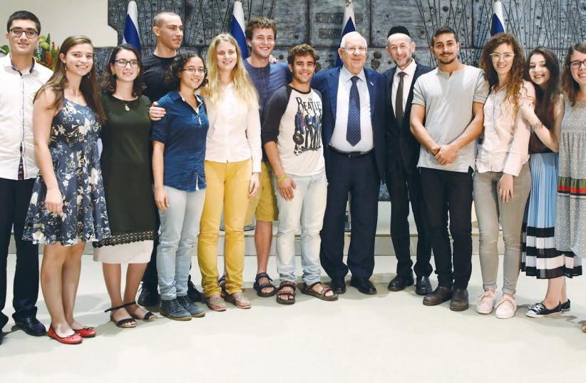 PRESIDENT REUVEN RIVLIN celebrates with the winners of the 2017 Young Scientists and Developers Competition, held annually at Jerusalem's Bloomfield Science Museum, on March 21 (photo credit: AVI HAYOUN)