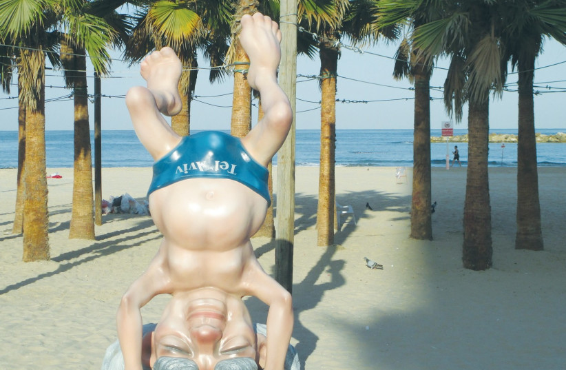 A STATUE OF David Ben-Gurion shows Israel's first prime minister doing a headstand on Frishman Beach in Tel Aviv. (photo credit: WIKIMEDIA)
