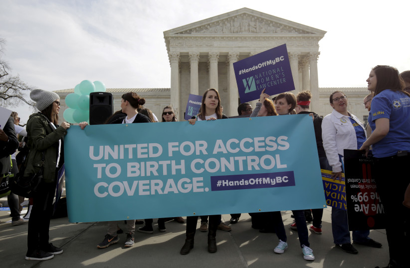 Supporters of contraception rally in Washington DC.  (photo credit: REUTERS)