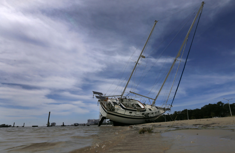 A sail boat is seen washed ashore after Hurricane Nate in Biloxi. (photo credit: REUTERS)