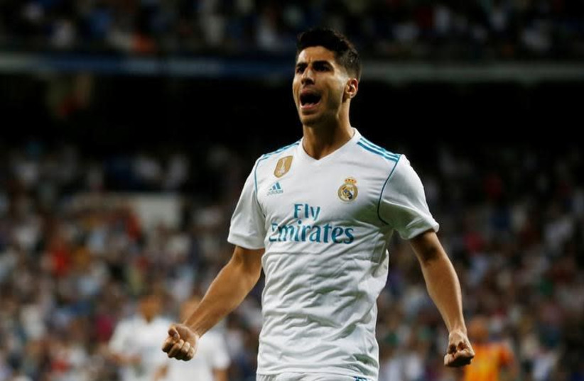 Marco Asensio celebrates a goal. (photo credit: REUTERS/JAVIER BARBANCHO)