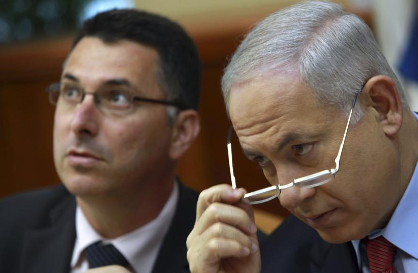 Prime Minister Benjamin Netanyahu (R) and Gideon Sa'ar  (photo credit: REUTERS)