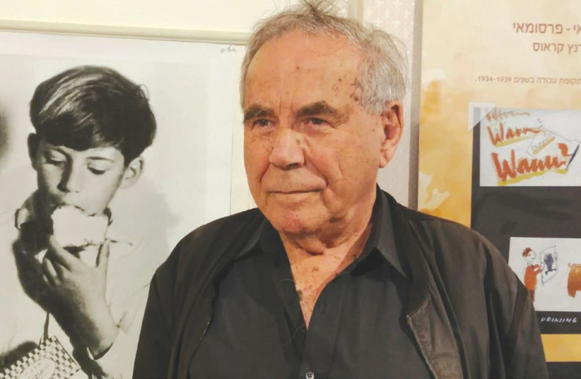 STEF WERTHEIMER stands beside a photo of himself from 81 years ago when he appeared in a margarine advertisement. (The Open Museum Tefen)  (photo credit: Courtesy)