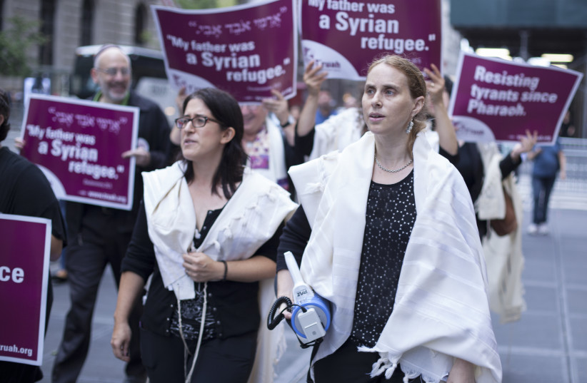 Rabbi Rachel Kahn Troster, T'ruah's director of programs (left) and Rabbi Jill Jacobs, Truah's executive director (right) marching along 5th Avenue. (photo credit: CHRISTOPHER PARKS)