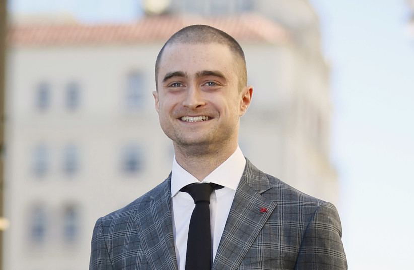 Radcliffe stands during a ceremony honoring him with a star on the Hollywood Walk of Fame in Hollywood. (photo credit: REUTERS)