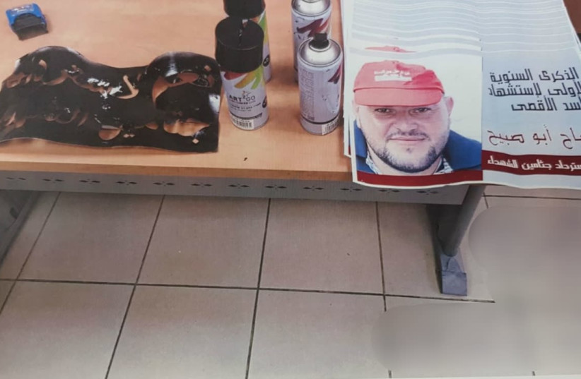 Graffiti and posters glorifying terrorist in east Jerusalem caught by police (photo credit: COURTESY ISRAEL POLICE)