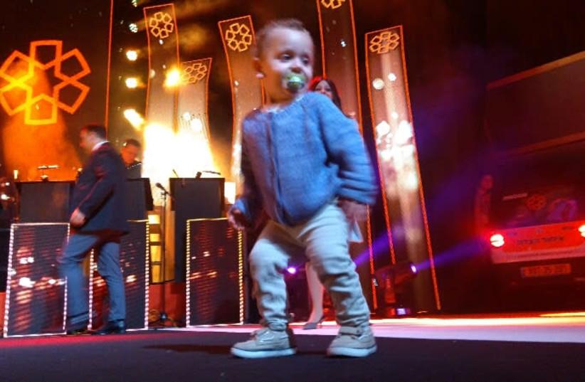 Two year old Elchanan dancing on stage    (photo credit: UNITED HATZALAH)