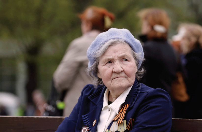 A WOMAN wears her medals during Victory Day celebrations in Riga, Latvia, in 2014, celebrating the victory of the Soviet Union's Red Army over Nazi Germany in World War II. (photo credit: REUTERS/INTS KALNINS)