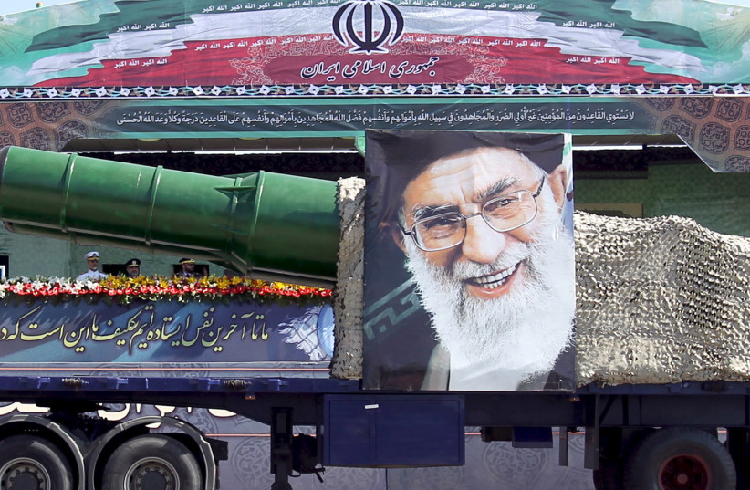 A military truck carrying a missile and a picture of Iran's Supreme Leader Ayatollah Ali Khamenei i (photo credit: REUTERS)
