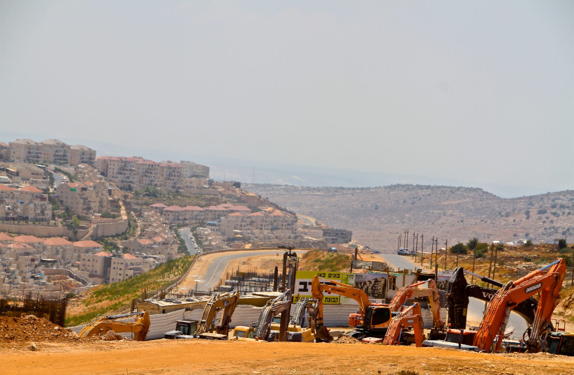 building cranes in the Beitar Illit settlement August 17   (photo credit: TOVAH LAZAROFF)