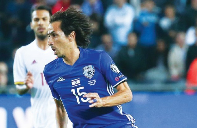 Yossi Benayoun made what was likely his final appearance for the Israel national team in Monday's 1-0 defeat to Spain, but his expected retirement is only one of many contributing factors to the blueand- white's uncertain future. (photo credit: DANNY MARON)