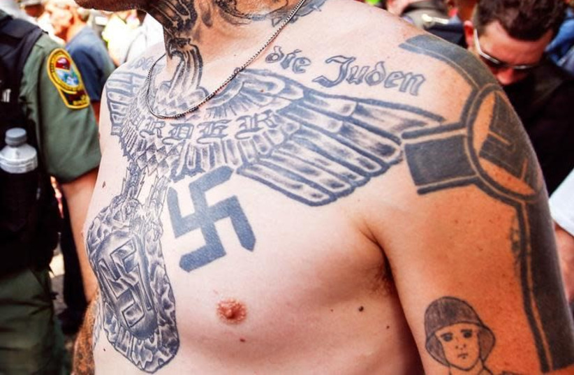 A supporter of the Ku Klux Klan is seen with his tattoos during a rally at the statehouse in Columbia, South Carolina July 18, 2015. (photo credit: REUTERS/CHRIS KEANE)