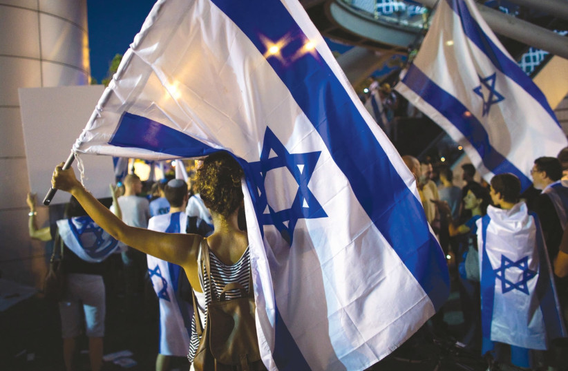 Protestors at a rally in Tel Aviv. The author argues that protesting at politicians' homes is unethical. (photo credit: REUTERS)