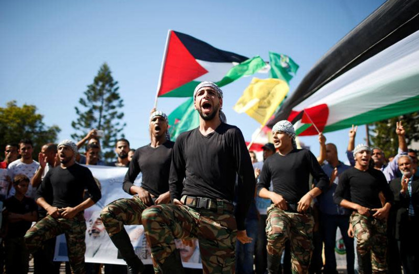 Palestinians parade during celebrations after Hamas said it reached a deal with Palestinian rival Fatah, in Gaza City, October 12, 2017. (photo credit: REUTERS/SUHAIB SALEM)