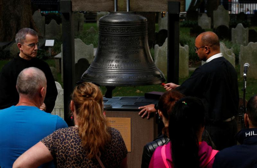 People gather to ring the Bell of Hope, which is rung to remember victims of terrorism and violence around the world, to honour those killed and injured in the Las Vegas mass shooting, at St. Paul's Chapel in New York City, US, October 3, 2017. (photo credit: REUTERS/BRENDAN MCDERMID)