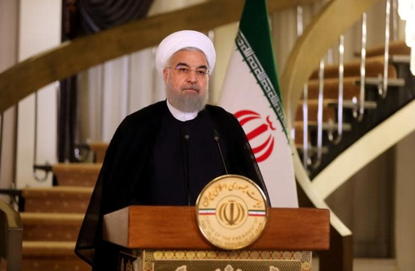 Iranian President Hassan Rouhani delivers a television address in Tehran, Iran, October 13, 2017.  (photo credit: HANDOUT/REUTERS)