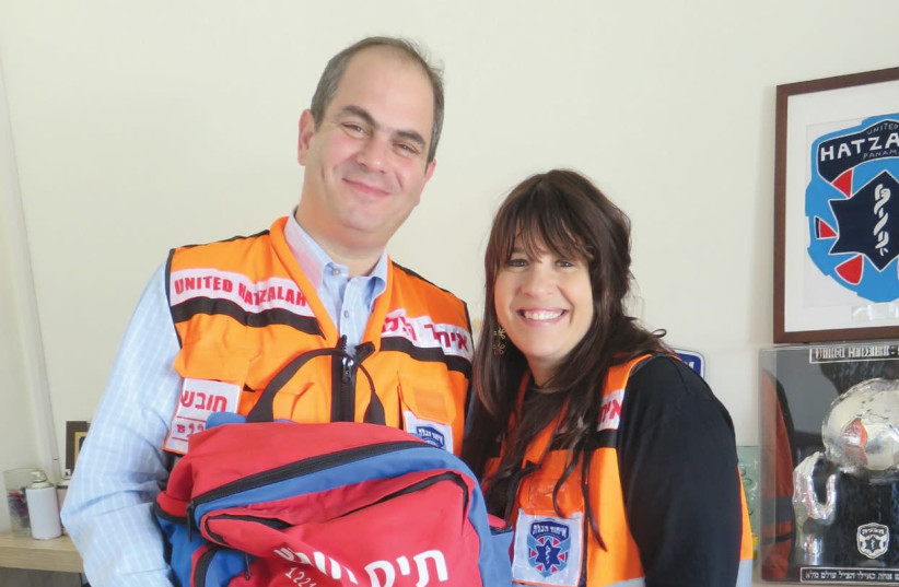 ELI AND GITTY BEER, with matching United Hatzalah vests, are both trained medics (photo credit: JUDY SIEGEL-ITZKOVICH)