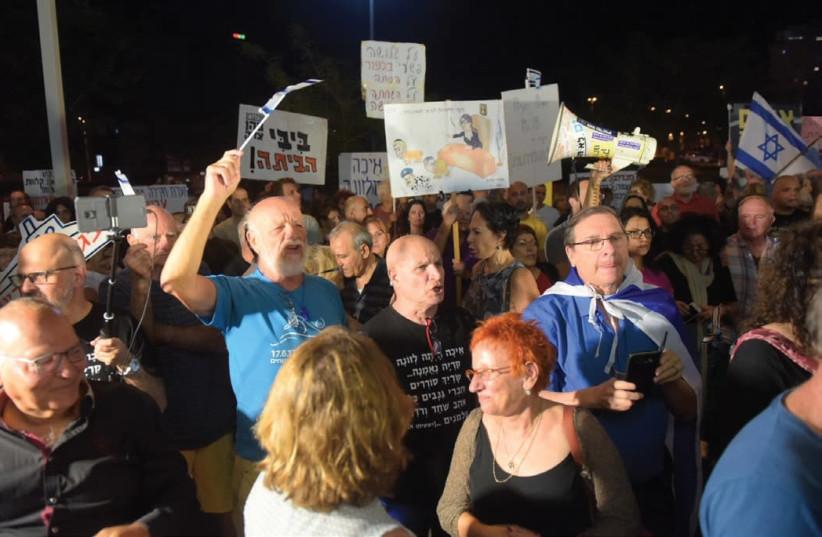 SOME 300 PEOPLE protest near Attorney-General Avichai Mandelblit's home in Petah Tikva last night, calling on him to indict Prime Minister Benjamin Netanyahu on corruption  (photo credit: AVSHALOM SASSONI)