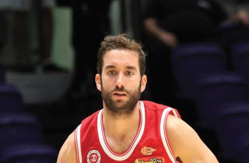 Hapoel Jerusalem guard Yogev Ohayon returned from injury last night, playing 13 minutes and scoring two points in his team's BSL win over Maccabi Rishon Lezion (photo credit: ADI AVISHAI)
