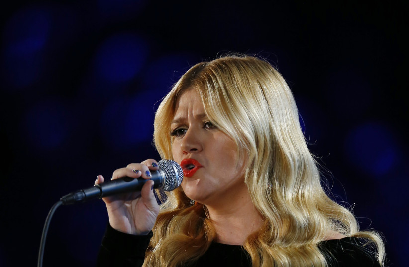 Kelly Clarkson performs at the 55th annual Grammy Awards in Los Angeles. (photo credit: REUTERS)