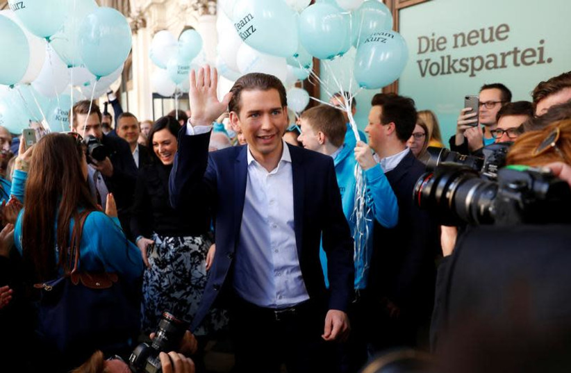 Top candidate of Peoples Party (OeVP) and Foreign Minister Sebastan Kurz arrives in front of his party's headquarters in Vienna, Austria October 13, 2017.  (photo credit: LEONHARD FOEGER / REUTERS)