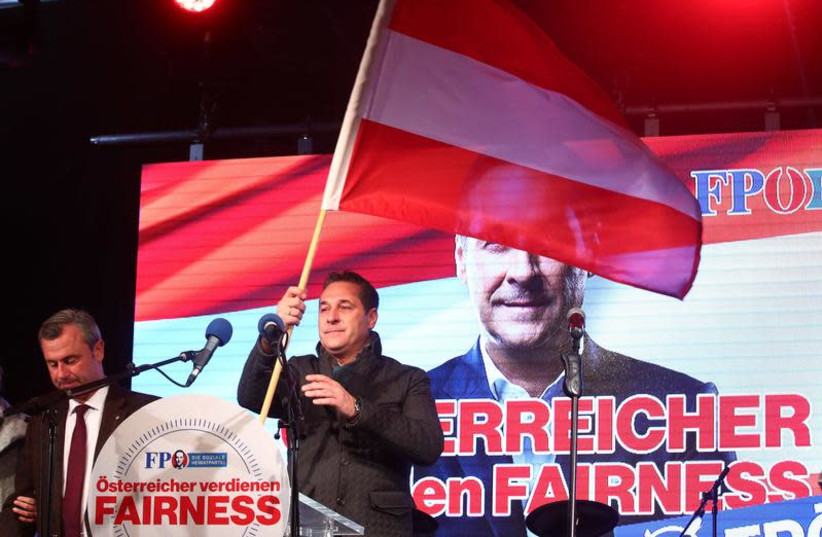 Norbert Hofer (L) and Austrian Freedom Party (FPOe) top candidate Heinz-Christian Strache attend their party's final election campaign rally in Vienna, Austria, October 13, 2017.  (photo credit: MICHAEL DALDER/REUTERS)