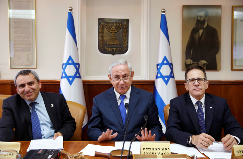 Israeli Prime Minister Benjamin Netanyahu (C), Minister of Environmental Protection Ze'ev Elkin (L) and Cabinet Secretary Tzachi Braverman (R) attend the weekly cabinet meeting in Jerusalem. (photo credit: REUTERS)