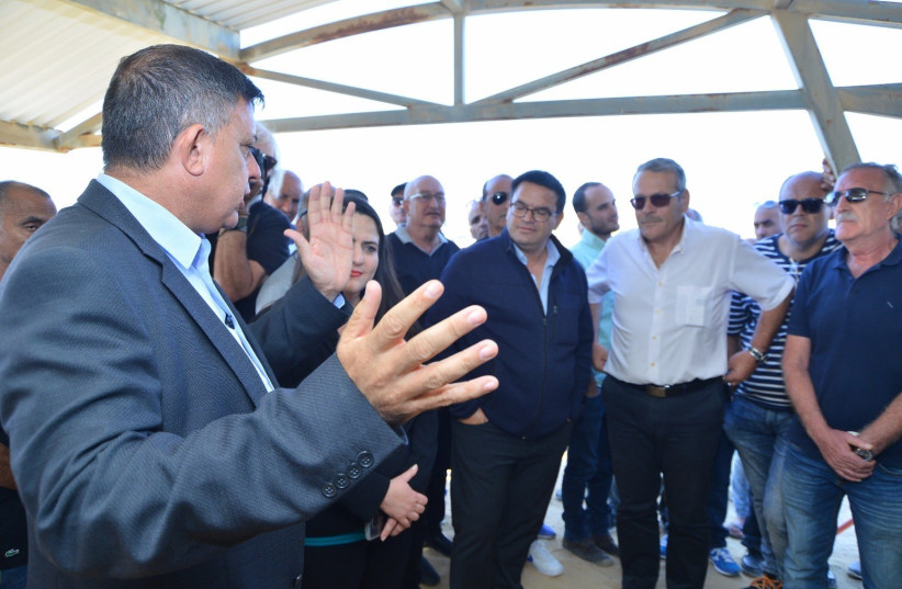 Opposition leader and Labor party head Avi Gabbay (left) meets with Negev Ceramics workers and the mayor on Sunday in Yeroham. (photo credit: COURTESY OF AVI GABBAY)