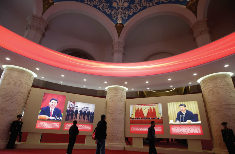 People visit an exhibition displaying China's achievements over the past five years as part of the celebrations of the upcoming 19th National Congress of the Communist Party of China (CPC) at the Beijing Exhibition Center. (photo credit: REUTERS)