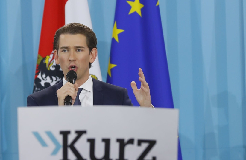 Top candidate of the People's Party (OeVP) Sebastian Kurz attends his party's victory celebration meeting in Vienna, Austria, October 15, 2017.  (photo credit: LEONHARD FOEGER / REUTERS)