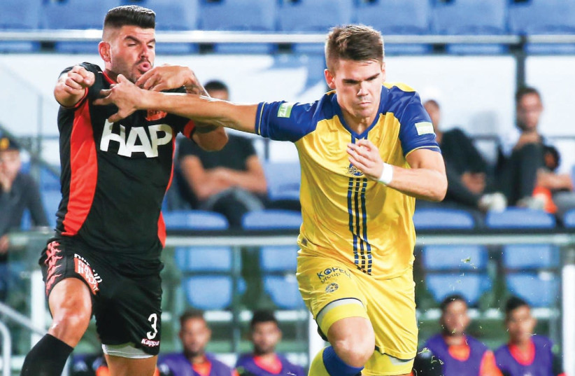 Maccabi Tel Aviv striker Vidar Orn Kjartansson (right) scored his team's opener in last night's 2-0 win over Ben Turgeman (left) and Bnei Yehuda in Premier League action (photo credit: DANNY MARON)