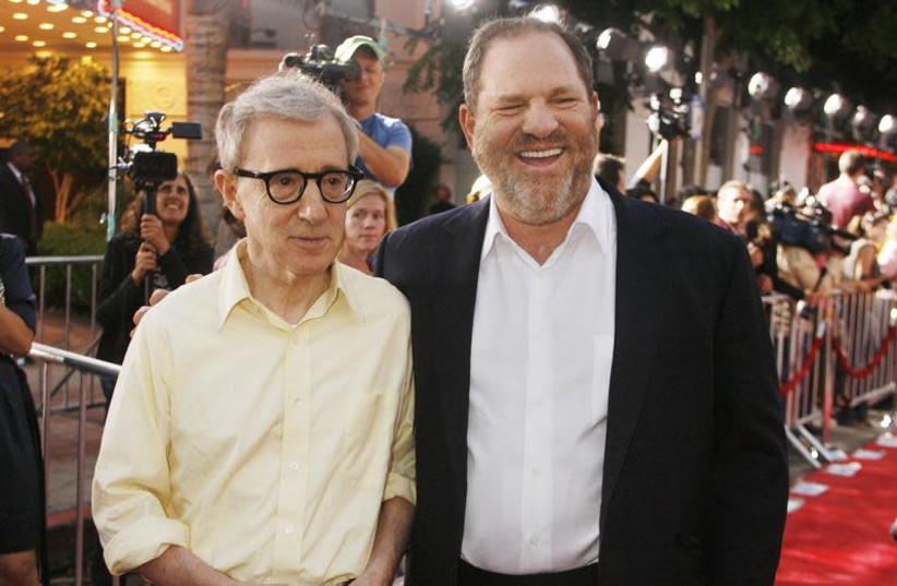 """Woody Allen, director of the new film """"Vicky Cristina Barcelona"""", poses with Harvey Weinstein, co-chairman of The Weinstein Co., at the film's premiere in Los Angeles August 4, 2008 (photo credit: FRED PROUSER/REUTERS)"""