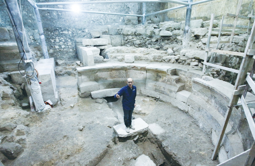 JOE UZIEL stands yesterday in the Roman theater uncovered during excavations of the Western Wall tunnels in Jerusalem. (photo credit: Israel Antiquities Authority)