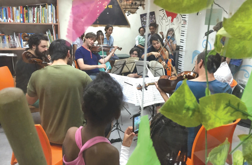 MUSETHICA MUSICIANS play in front of a group of children in Israel. (photo credit: ZVIKA ZOREF)