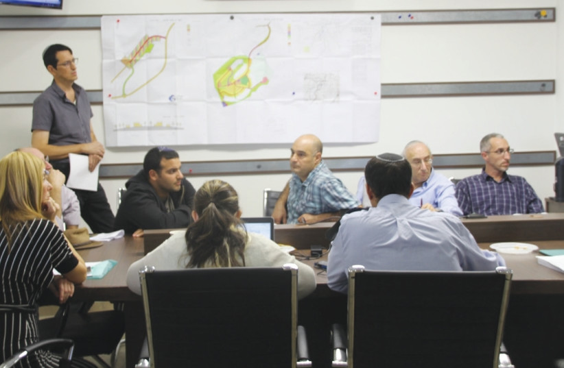 The Higher Planning Council for Judea and Samaria discusses plans on Tuesday to build more homes in the West Bank. (photo credit: TOVAH LAZAROFF)
