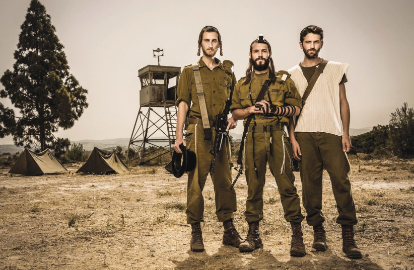 The protagonists of 'Kippat Barzel,' playing infantrymen in the Netzah Yehuda Battalion, pose at their base. (photo credit: ODED KARNI)
