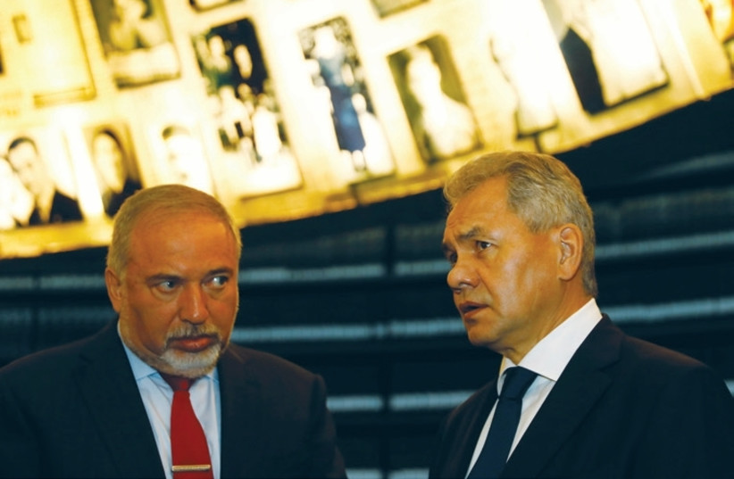 Defense Minister Avigdor Liberman (left) stands with his Russian counterpart, SergeiShoigu, during a visit to Yad Vashem in Jerusalem yesterday. (photo credit: RONEN ZVULUN / REUTERS)