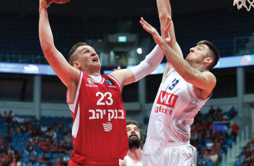 Hapoel Jerusalem center Alen Omic (left) scored 14 points last night, but it wasn't enough to beat Aleksa Ilic and Buducnost, which left the Jerusalem Arena with an 86-81 victory in Eurocup action. (photo credit: DANNY MARON)