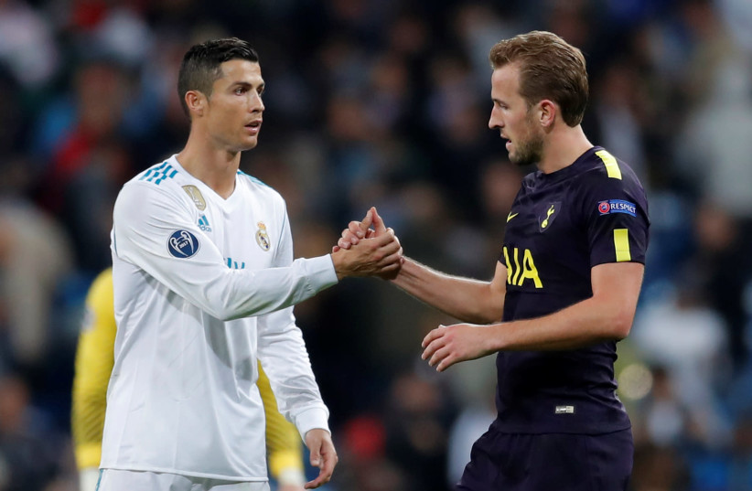 Tottenham's Harry Kane and Real Madrid's Cristiano Ronaldo shake hands after the match. (photo credit: ANDREW COULDRIDGE/REUTERS)