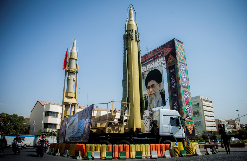 A display of missiles and a portrait of Supreme Leader Ayatollah Ali Khamenei in Tehran (photo credit: REUTERS)