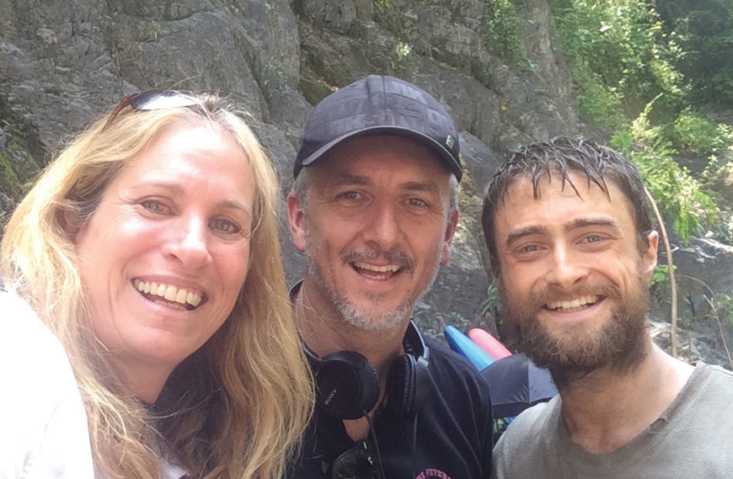 'Jungle' producer Dana Lustig (left) is seen here with director Greg McLean and actor Daniel Radcliffe on the set of the movie. (photo credit: Courtesy)