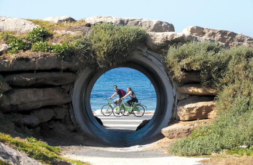 People enjoy a bike ride along Tel Aviv's promenade. (photo credit: MARC ISRAEL SELLEM)