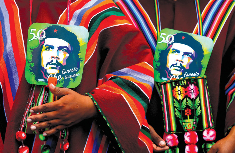 Images of Ernesto 'Che' Guevara at a ceremony commemorating the Argentinean revolutionary's death in Bolivia. (photo credit: DAVID MERCADO/REUTERS)