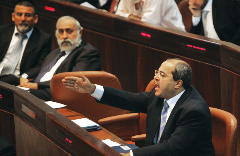 MK Ahmad Tibi (Joint List) was removed from the Knesset after shouting out that the Nation-State bill is racist. (photo credit: MARC ISRAEL SELLEM)
