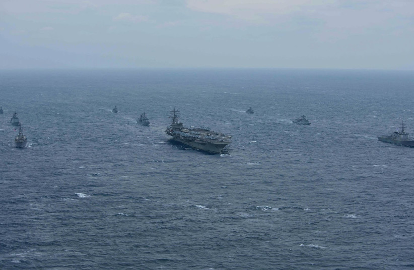 The aircraft carrier USS Ronald Reagan and the Arleigh Burke-class destroyer USS Stethem are underway alongside ships from the Republic of Korea (ROK) Navy in the waters east of the Korean Peninsula Wednesday. (photo credit: REUTERS)